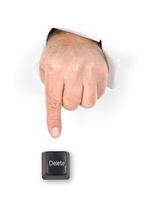 A hand with index finger extended pokes through torn paper prepares to push the delete key.
