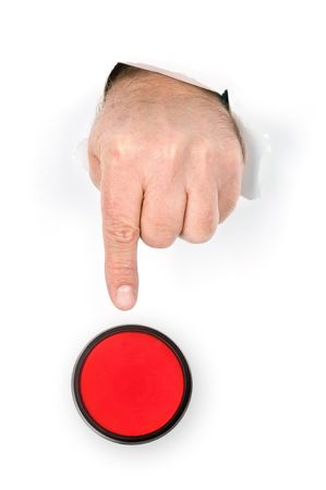 A hand with index finger extended pokes through torn paper prepares to push the panic stop button. photo