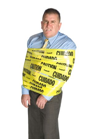 An angry businessman wrapped in caution tape as a warning to coworkers snarls as a result of stress and frustration Stock Photo - 6671841