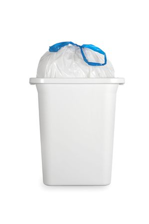 A white trash can with a full plastic garbage bag tied with a blue draw band.