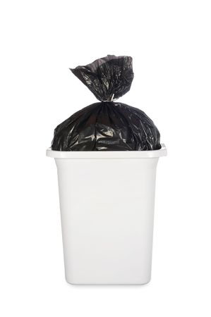 black plastic garbage bag: A white trash can with a black trash bag full of garbage. Stock Photo