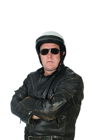 A macho motorcycle rider posing while wearing his leather jacket, white helmet and sun glasses. photo