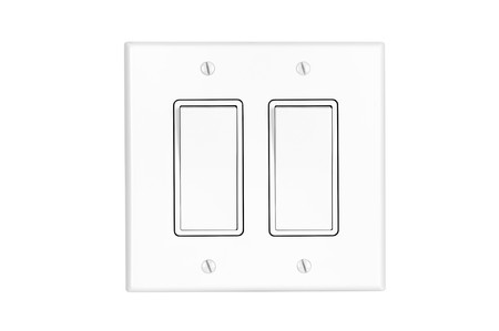 A modern white dual toggle electrical light switch isolated on white. photo