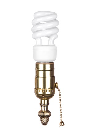 An energy efficient spiral light bulb and brass light socket with pull chain isolated on white. Stock Photo - 7443714