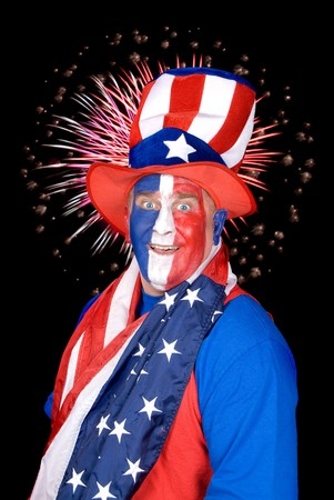 A patriotic man dressed in red, white and blue with fireworks in the black sky. Stock Photo - 7443099