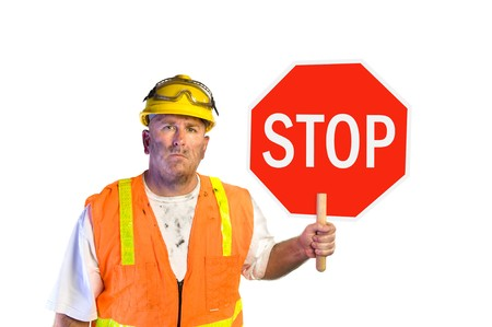 Construction worker with stop sign isolated on white photo