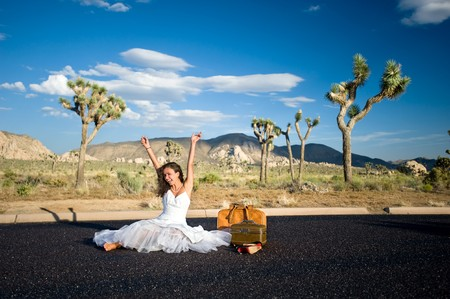 A bride dumped off in the middle of nowhere celebrates her new freedom. photo