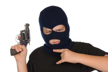 A young boy flashes his gang sign and weapon to show his committment to crime and bad ways. Stock Photo - 7443159