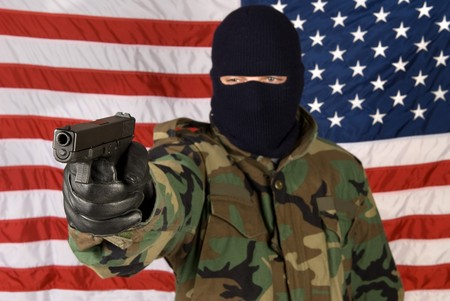 finger on trigger: A man prepares to defend his country against all evil.
