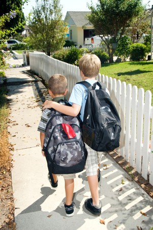 first day: Brothers walk home from their first day at school