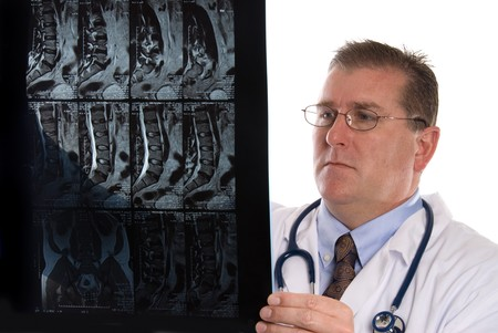 inference: Conceptual image of a doctor examining a patients MRI.  Intended for any use where a medical inference is needed.