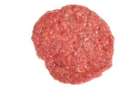 raw meat: A raw hamburger patty isolated on white. Stock Photo