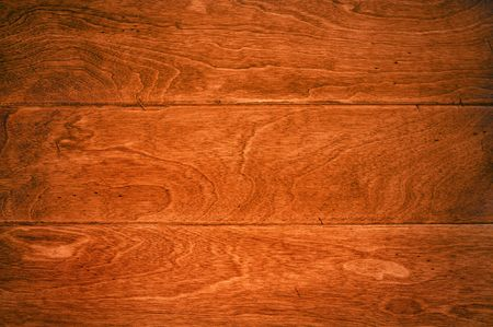A beautiful deep, rich hardwoor floor with its wood grain details for use as and background or appropriate housing inference.  Stock Photo - 7909506