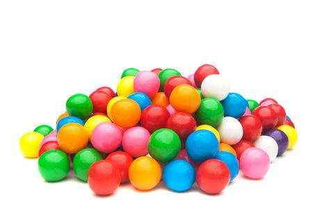 A pile of colorful gumballs on a white background. Stockfoto