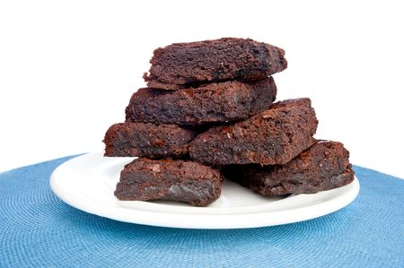 brownies: A plate full of fresh brownies on a plate with a white background