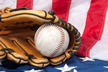 A baseball glove and baseball on an American flag. Stock Photo - 7909513