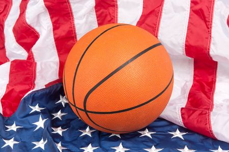 A basketball on an American flag show a patriotic sport photo
