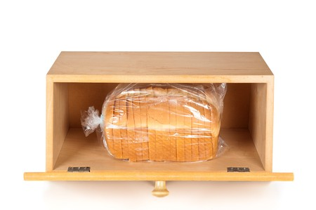 A breadbox with a fresh loaf of bread on a white background.