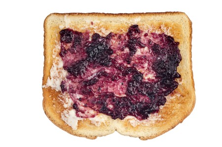 A slice of toasted white bread with butter and grape jelly spread. photo