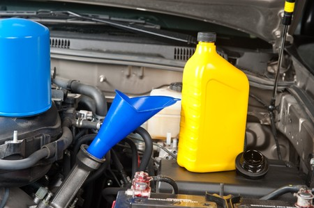 oil change: Preparation for an oil change and general maintenance on an automobile engine.
