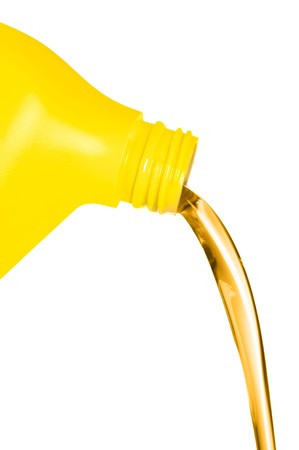 oil change: A plastic container of engine oil pouring in front of a white background.  For use as a design element or automobile maintenance inference.