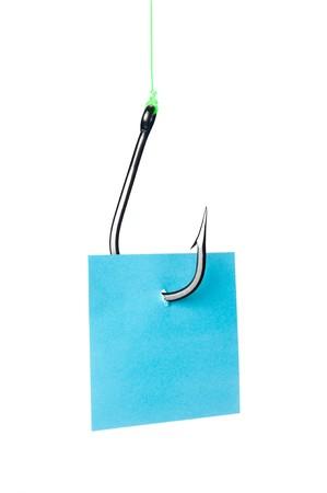 bajo y fornido: Una nota de robustas azul con espacio para copia en un fishook de acero inoxidable.  Foto de archivo
