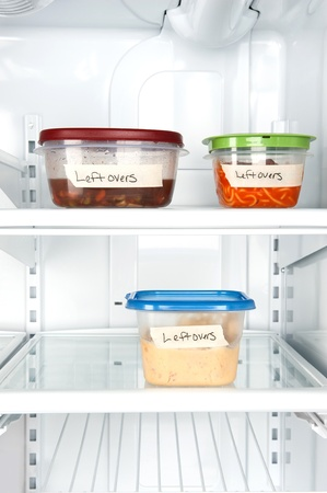Leftover containers of food in a refrigerator for use with many food inferences. photo