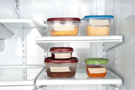 food preservation: Leftovers in a refrigerator with blank tape for copy.