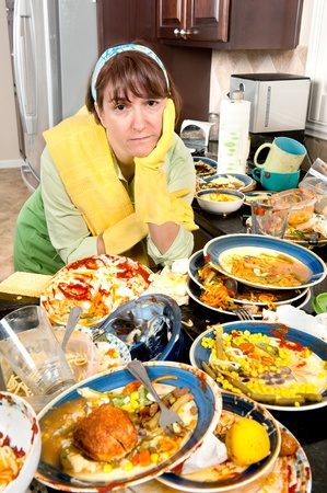 messy: A homemaker get ready to wash dishes with little enthusiasm.