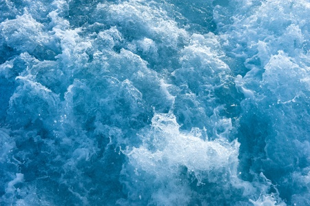 churning: Churning blue water in the ocean shows lots of turbulance and splash.  Good for background image. Stock Photo