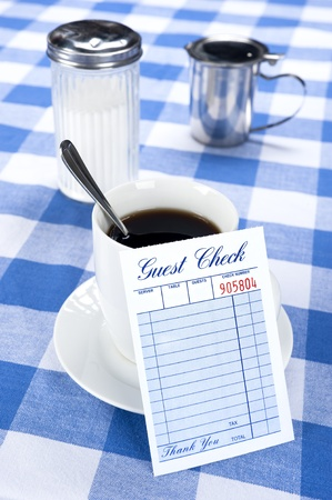 A breakfast and coffee setting in a cafe diner with a blank check for placement of copy.   photo