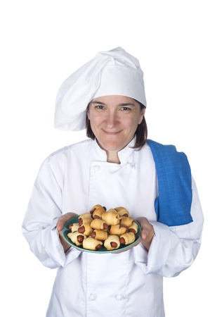A female chef shows off her latest meal.  Isolated on white for designer convenience. Stock Photo - 8622428