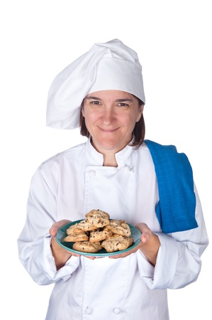 A female chef shows off a plate of freshly baked cookies.  Isolated on white for designer convenience. Stock Photo - 8622434