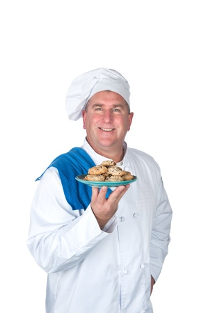 A chef holds up a plate of freshly baked cookies. Stock Photo - 8622380