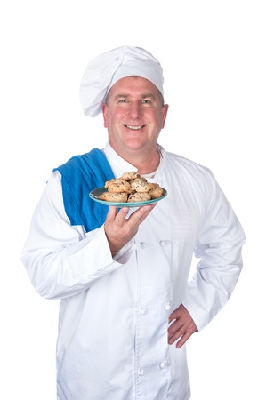 A chef holds up a plate of freshly baked cookies. Stock Photo - 8622410