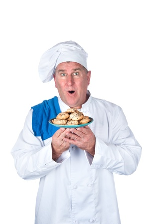An excited chef with plate of cookies isolated on white. Stock Photo - 8622409