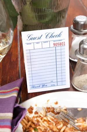 dinnertime: A restaurant dinnertime guest check left blank for placement of copy Stock Photo