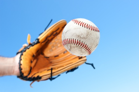 A baseball player and outfielder prepares to catch a fly ball.