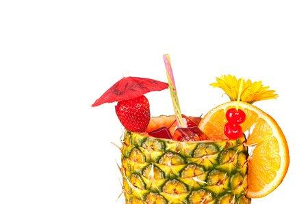 pineapple  glass: A cold, refreshing tropical rum drink with a pineapple glass, strawberry, cherries and an orange slice isolated on a white background.