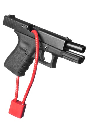 black and white lock: A hand gun firearm is locked with a safety cable to prevent anyone from firing the weapon.