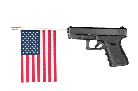 A pistol shoots out a flag.  Isolated on white. Stock Photo - 8884106