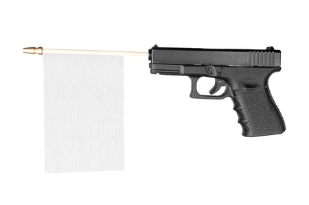 A flag with room for copy sticks out of a gun isolated on white. Stock Photo - 8884068