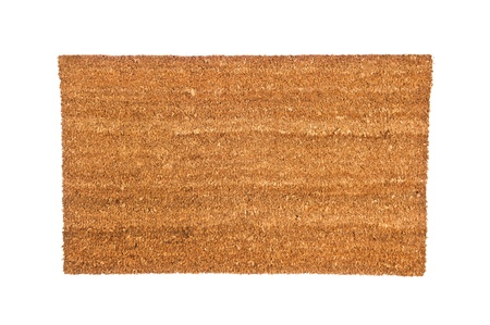 place mat: A plain brown doormat isolated on white.  Designed can use to place any copy on top of the mat.