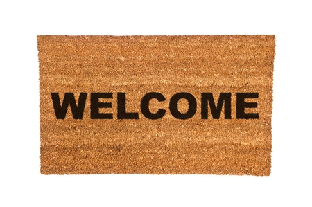 cor: A new welcome doormat isolated on a white background.