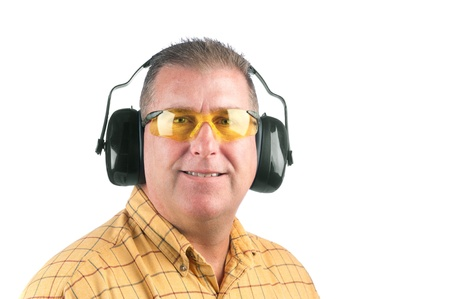 hearing protection: A worker wearing yellow safety glasses and hearing protection. Stock Photo