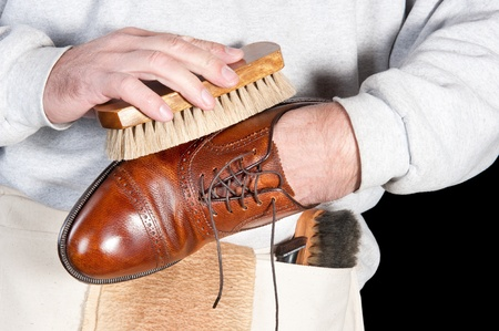 A shoeshine man polishing a leather dress shoe Banco de Imagens
