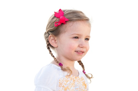 A little three year old girl on a white background smiling. photo