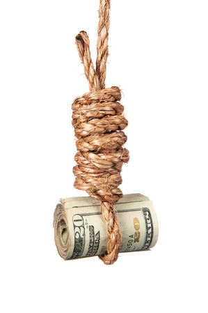 tough times: A roll of cash in a noose depicting tough economic times, devaluation, recession and financial collapse.