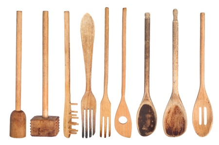 A collection of wooden kitchen utensils isolated on white photo