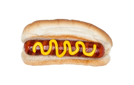 A freshly grilled hotdog on a bun with a stream of mustard isolated on white. Banco de Imagens